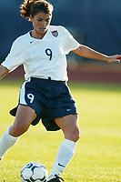 Mia Hamm shoots and scores her second goal of the game as the USWNT defeated Russia 5-1 on  September 29, at Mitchel Athletic Complex, Uniondale, NY.