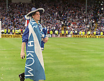 Brian Laudrup walks in front of the Rangers fans draped in a saltire, sombrerro and clutching his winner's medal and a teddy bear..1996 Scottish Cup Final, Hampden