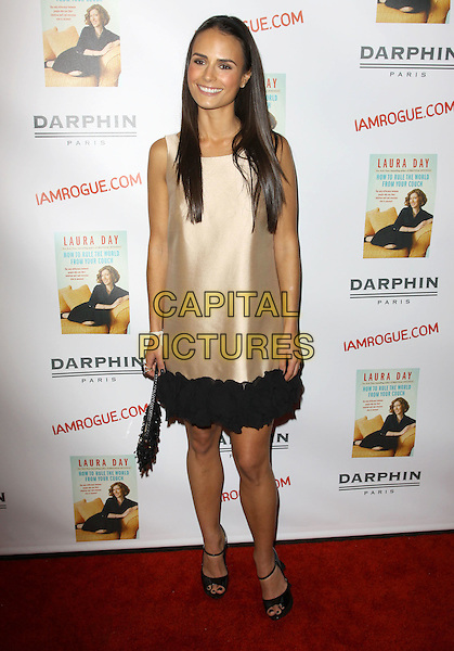 "JORDANA BREWSTER.Laura Day's new book ""How to Rule the World from Your Couch"" Celebration held At STK Restaurant, Los Angeles, California, 19th October 2009..full length sleeveless cream black trim dress open toe sandals shoes ankle strap silk satin bag gold .CAP/ADM/KB.©Kevan Brooks/AdMedia/Capital Pictures."