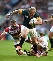 Adriaan Strauss of South Africa takes on the Japan defence. Rugby World Cup Pool B match between South Africa and Japan on September 19, 2015 at the Brighton Community Stadium in Brighton, England. Photo by: Patrick Khachfe / Onside Images