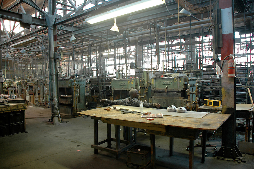 A lone factory worker, at a west end Toronto factory undergoing closure and site redevelopment