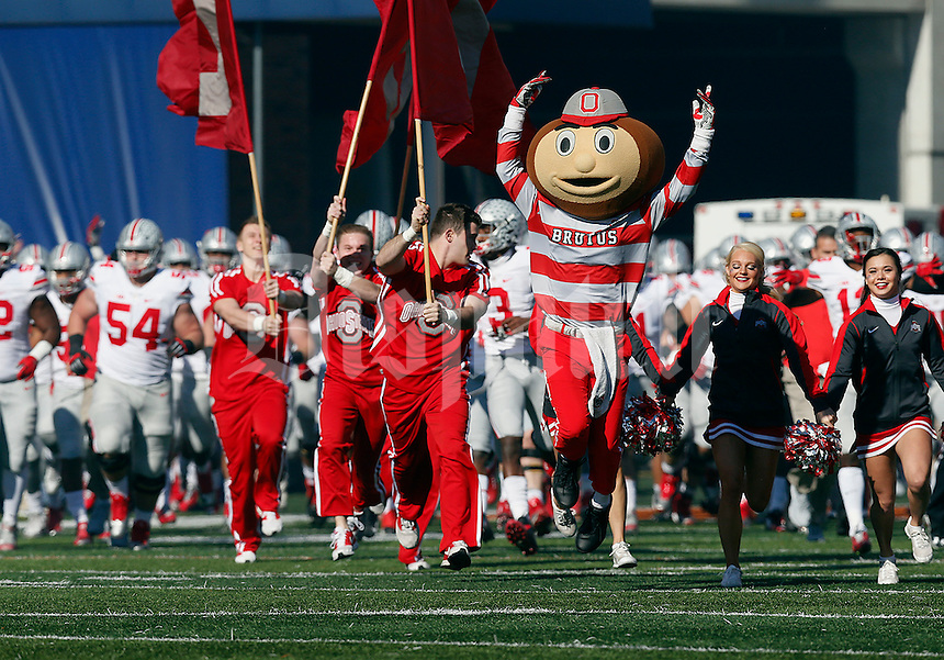 Brutus Buckeye leads the team onto the field before their game at Memorial Stadium in Champaign, Ill on November 14, 2015. (Columbus Dispatch photo by Brooke LaValley)