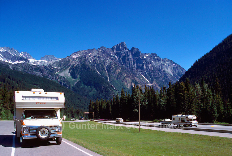 Rogers Pass Summit (Elev 1,382 m / 4,534 ft) in Glacier National Park, BC, British Columbia, Canada - Recreational Vehicles travelling on Trans Canada Highway 1 in Canadian Rockies