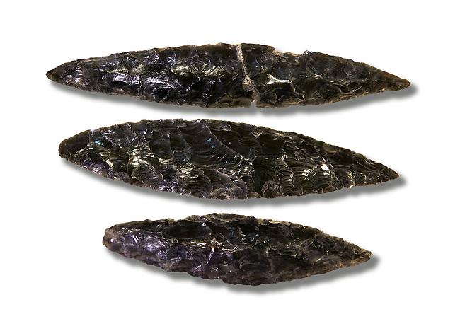 Black obsidian blades. Catalhoyuk Collections. Museum of Anatolian Civilisations, Ankara. Against a white background