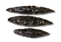 Black obsidian blades. Catalhoyuk Collections. Museum of Anatolian Civilisations, Ankara. Against a white background