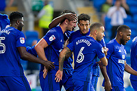 Sean Morrison of Cardiff City (second left) is congratulated after scoring his side's first goal during the Sky Bet Championship match between Cardiff City and Sheffield United at Cardiff City Stadium, Cardiff, Wales on 15 August 2017. Photo by Mark  Hawkins / PRiME Media Images.