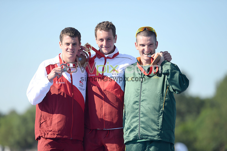(L to R) Jonathan Brownlee, Alistalr Brownlee and Richard Murray, Mens Triathlon at Strathclyde Country Park. Glasgow Commonwealth Games 2014. Monday 24 July 2014. Scotland. Photo: Delly Carr/Photosport.co.nz
