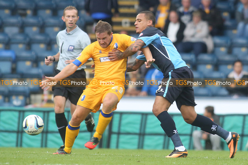 Mansfield's Jamie McGuire and Dean Morgan of Wycombe - Wycombe Wanderers vs Mansfield Town - Sky Bet League Two Football at Adams Park, High Wycombe - 17/08/13 - MANDATORY CREDIT: Paul Dennis/TGSPHOTO - Self billing applies where appropriate - 0845 094 6026 - contact@tgsphoto.co.uk - NO UNPAID USE