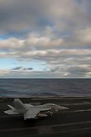 120506-N-DR144-004 PACIFIC OCEAN (May 6, 2012) An F/A-18F Super Hornet assigned to Strike Fighter Squadron (VFA) 22 recovers aboard the Nimitz-class aircraft carrier USS Carl Vinson (CVN 70). Carl Vinson and Carrier Air Wing (CVW) 17 are deployed to the 7th Fleet area of operations. (U.S. Navy photo by Mass Communication Specialist 2nd Class James R. Evans/Released)