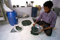 In Jaipur India, the world capital leader of Emerald cutter, this men is in charge of calibrating the blue barrel full of emeralds from south America