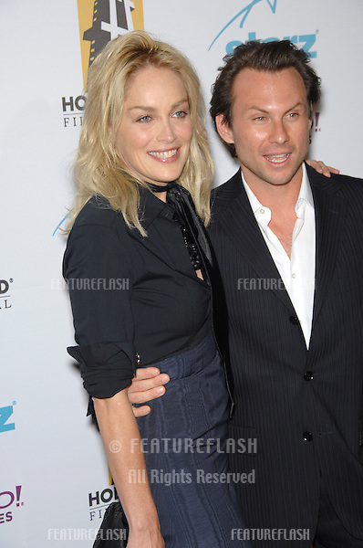 SHARON STONE & CHRISTIAN SLATER at the 10th Annual Hollywood Awards Gala - the closing gala of the 2006 Hollywood Film Festival - at the Beverly Hills Hilton. .October 23, 2006  Los Angeles, CA.Picture: Paul Smith / Featureflash