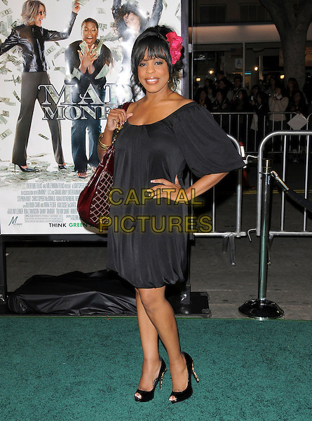 "NIECY NASH .Overature Pictures' L.A. Premiere of ""Mad Money"" held at The Mann Village Theatre in Westwood, California, USA..January 9th, 2008.full length black dress burgundy red maroon oversized large big bag purse flower in hair pink hand in hip                                   .CAP/DVS.©Debbie VanStory/Capital Pictures"