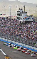 Nov. 9, 2008; Avondale, AZ, USA; NASCAR Sprint Cup Series drivers race down the front stretch during the Checker Auto Parts 500 at Phoenix International Raceway. Mandatory Credit: Mark J. Rebilas-