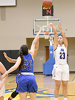 Bud Sullins/Special to Siloam Sunday<br /> John Brown senior Karina Chandra shoots over a pair of Central Christian (Kan.) defenders during Thursday's game at Bill George Arena. Chandra scored 18 of her game-high 19 points in the second half as JBU rallied for a 83-60 victory.