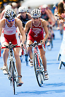 17 JUL 2011 - HAMBURG, GER - Barbara Riveros Diaz (CHI) cycles through the spectator lined streets of Hamburg during the women's round of triathlon's ITU World Championship Series .(PHOTO (C) NIGEL FARROW)