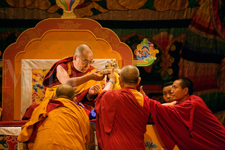 The14th DALAI LAMA blesses sacred objects while teaching ATISHA'S LAMP FOR THE PATH TO ENLIGHTENMENT in October 2007 sponsored by KUMBUM CHAMTSE LING & the TIBETAN CULTURAL CENTER - BLOOMINGTON, INDIANA