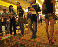 "Prostitutes wander the floor of the largst Casino in asia, the Venetian in Macau, 25th October 2008.  Macau is known simply as ""Vegas"" in China. The former Potuguese colony, now a Chinese Special Administrative Region, attracts millions of Chinese gamblers annually and last year earned more gambling dollars than Las Vegas."