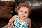13 month old baby girl at home portrait closeup horizontal