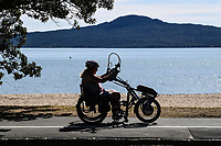 1st April 2020, Kohi Beach, Auckland, New Zealand;  A woman on a bike makes the most of the warm weather during the lockdown due to Covid-19. Kohimarama, Auckland, New Zealand on Wednesday 1 April 2020.