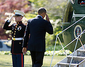 United States President Barack Obama salutes the Marine Guard as he boards Marine 1 to depart the White House in Washington, D.C. for a trip to Miami, Florida and the Summit of the Americas on Friday, April 13, 2012..Credit: Ron Sachs / CNP