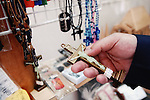 A visitor looks at a cross on sale at a museum in Shingo Village, Aomori Prefecture, northern Japan. Some residents of Shingo say that Jesus spent 12 years in Japan and is buried in the village.