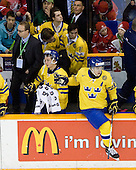 Par Marts (Sweden - Head Coach), Oliver Ekman Larsson (Sweden - 3), Tim Erixon (Sweden - 4), Marcus Johansson (Sweden - 11), Jacob Josefson (Sweden - 10), Magnus Paajarvi Svensson (Sweden - 21) - Team Sweden celebrates after defeating Team Switzerland 11-4 to win the bronze medal in the 2010 World Juniors tournament on Tuesday, January 5, 2010, at the Credit Union Centre in Saskatoon, Saskatchewan.