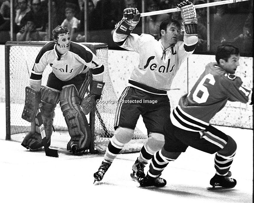 Seals vs. Blackhawks: goalie Gary Smith and Ted Hampson, BlackHawk #16 Chico Maki. (photo 1970 by Ron Riesterer)