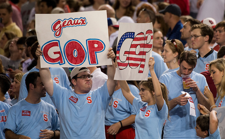 UNITED STATES - JUNE 25: The Rep. Steve Scalise cheering section holds up signs during the Roll Call Congressional Baseball Game on Wednesday, June 25, 2014. (Photo By Bill Clark/CQ Roll Call)