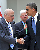 Washington, D.C. - June 22, 2009 -- United States President Barack Obama, right, shakes hands with U.S. Representative John Dingell (Democrat of Michigan), left, after signing the Family Smoking Prevention and Tobacco Control Act in the Rose Garden of the White House on Monday, June 22, 2009.  U.S. Senator Chris Dodd (Democrat of Connecticut) looks on from center..Credit: Ron Sachs - Pool via CNP