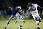 CARY, NC - OCTOBER 06: UNC's Zach Wright (10) and Wake Forest's Ema Twumasi (GHA) (22). The University of North Carolina Tar Heels hosted the Wake Forest University Demon Deacons on October 6, 2017 at Koka Booth Field at WakeMed Soccer Park in Cary, NC in a Division I college soccer game.