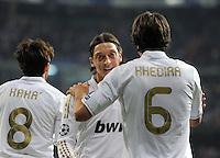 FUSSBALL   CHAMPIONS LEAGUE   SAISON 2011/2012  Achtelfinale Rueckspiel 14.03.2012 Real Madrid  - ZSKA Moskau  Mesut Oezil (Mitte, Real Madrid) umaramt von Sami Khedira (re, Real Madrid)