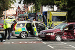 © Joel Goodman - 07973 332324 . 17/08/2013 . Manchester , UK . Police and ambulance crew on the scene . A suspected getaway vehicle (red Honda Accord) crashed in to a silver BMW following a knife-point robbery outside a bank on Northenden Road in Sale , Manchester yesterday afternoon (16th August 2013) . Police have arrested one man but report another is at large . Photo credit : Joel Goodman