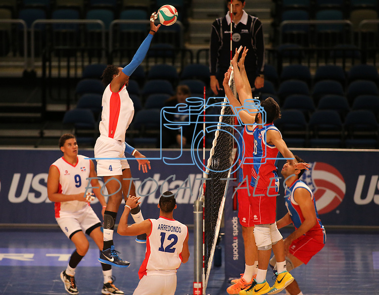 Dominican Republic's Wilfrido Hernandez hits against Puerto Rico during the Pan American Cup at the Reno Events Center in Reno, Nev., on Monday, Aug. 17, 2015. <br /> Photo by Cathleen Allison