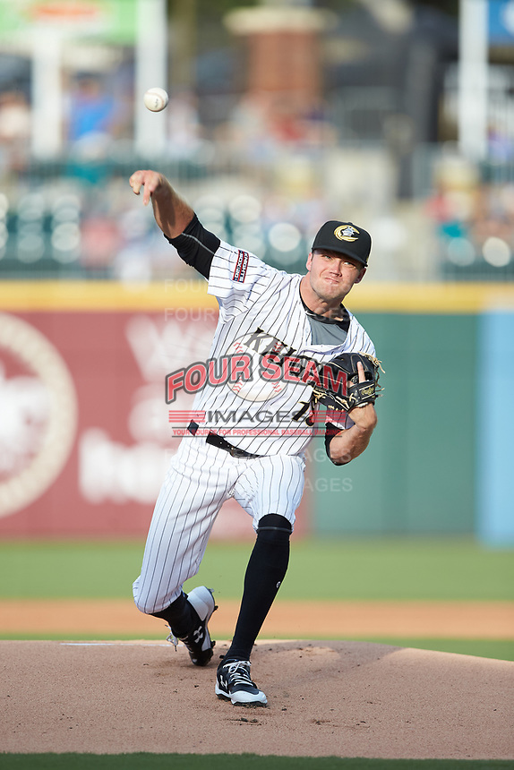 Charlotte Knights starting pitcher Spencer Adams (18) delivers a pitch to the plate against the Toledo Mud Hens at BB&T BallPark on June 22, 2018 in Charlotte, North Carolina. The Mud Hens defeated the Knights 4-0.  (Brian Westerholt/Four Seam Images)