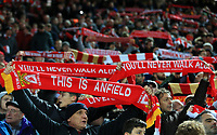 "30th October 2019; Anfield, Liverpool, Merseyside, England; English Football League Cup, Carabao Cup, Liverpool versus Arsenal; Liverpool fans hold their scarves aloft as ""You'll Never Walk Alone"" is sung prior to the kick off - Strictly Editorial Use Only. No use with unauthorized audio, video, data, fixture lists, club/league logos or 'live' services. Online in-match use limited to 120 images, no video emulation. No use in betting, games or single club/league/player publications"