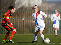 20140209 - TUBIZE , BELGIUM : Dutch Inessa Kaagman (r) pictured with Belgian Elke Van Gorp (l) during a friendly soccer match between the Under 19 ( U19) women teams of Belgium and The Netherlands , Sunday 9 February 2014 in Tubize . PHOTO DAVID CATRY