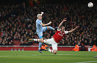 Leeds United's Ezgjan Alioski goes close in the first half with a header under pressure from Arsenal's Sokratis Papastathopoulos<br /> <br /> Photographer Rob Newell/CameraSport<br /> <br /> Emirates FA Cup Third Round - Arsenal v Leeds United - Monday 6th January 2020 - The Emirates Stadium - London<br />  <br /> World Copyright © 2020 CameraSport. All rights reserved. 43 Linden Ave. Countesthorpe. Leicester. England. LE8 5PG - Tel: +44 (0) 116 277 4147 - admin@camerasport.com - www.camerasport.com