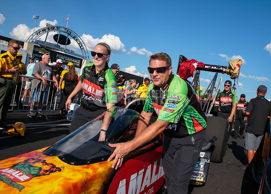 Sep 3, 2018; Clermont, IN, USA; Crew members push the car of NHRA top fuel driver Terry McMillen into the winners circle after winning the US Nationals at Lucas Oil Raceway. Mandatory Credit: Mark J. Rebilas-USA TODAY Sports