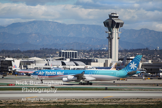 LOS ANGELES, CALIFORNIA, USA - JANUARY 28, 2013 -  Air Tahiti Nui Airbus A340 taxis at Los Angeles Airport on January 28, 2013. The plane has a range of range 3,300 miles with 150 passengers.