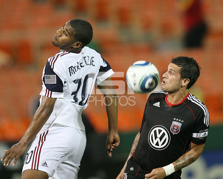 Santino Quaranta #25 of D.C. United  goes for a high ball with Rauwshan McKenzie #30 of Real Salt Lake during an Open Cup match at RFK Stadium, on June 2 2010 in Washington DC. DC United won 2-1.