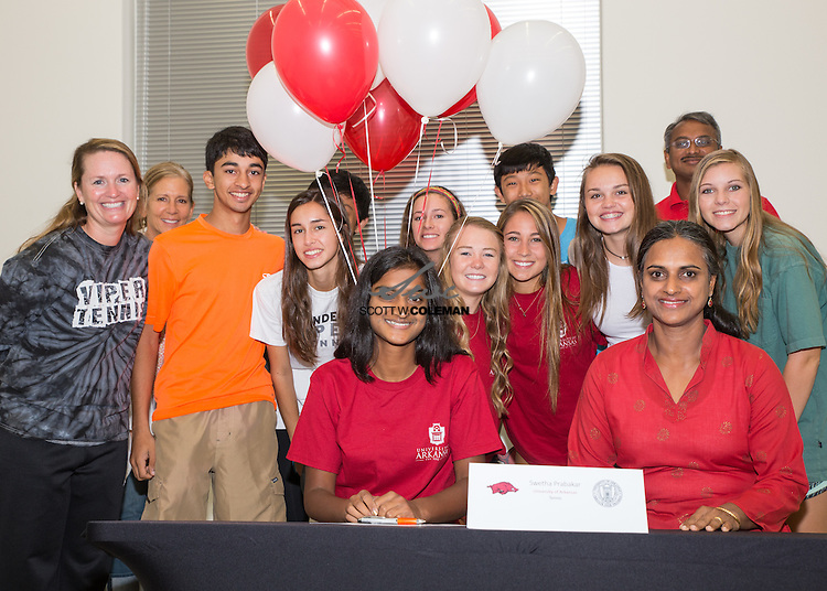 Vandegrift High School's Swetha Prabakar signs a letter of intent to play tennis at the University of Arkansas, on May 22, 2015.