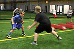 SIOUX FALLS, SD - JULY 2:  Campers Charlie Mickelson, left, looks to make a move past Jon Rames during drills at the Riggs Football Academy Tuesday night at the Sanford Fieldhouse. (Photo by Dave Eggen/Inertia)