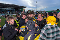 Supporters and players celebrate Yellows winning the 2019 Manawatu premier club rugby Hankins Shield final match between Varsity and Feilding Yellows at CET Arena in Palmerston North, New Zealand on Saturday, 13 July 2019. Photo: Dave Lintott / lintottphoto.co.nz