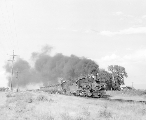 D&amp;RGW #486 and #487 double-heading a freight south of Alamosa.<br /> D&amp;RGW  Alamosa-Antonito, CO  Taken by McMurtry, W. Larry - 6/1959