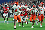 Clemson Tigers running back Travis Etienne (9) runs down field for a touchdowns during the Fiesta Bowl game against the Ohio State Buckeyes on Saturday, Dec 28, 2019 in Glendale, Ariz.  (Gene Lower via AP)