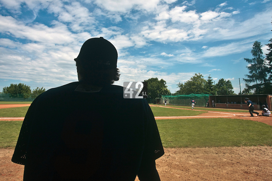 04 June 2010: Illustration of a player in the dugout watching the game during the 2010 Baseball European Cup match won 19-9 by Konica Minolta Pioniers over the Rouen Huskies, at the Kravi Hora ballpark, in Brno, Czech Republic.