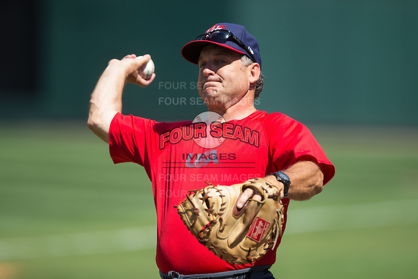 USCNT assistant coach Elliot Avent (26) warms up prior to throwing batting practice prior to the game against the Cuban National Team at BB&T BallPark on July 4, 2015 in Charlotte, North Carolina.  The United State Collegiate National Team defeated the Cuban National Team 11-1.  (Brian Westerholt/Four Seam Images)