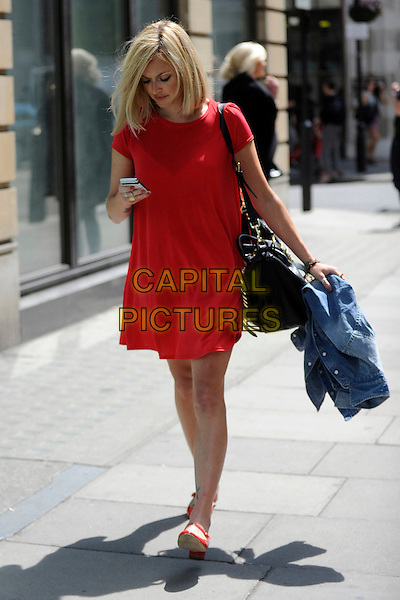 FEARNE COTTON .leaving BBC Radio 1 after her show, London, England, UK, June 1st 2011..full length walking mobile phone texting tattoo  red dress black bag patent shoes mary janes .CAP/IA.©Ian Allis/Capital Pictures.