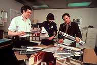 "Silicon Valley, California - February 1983. At the San Francisco airport, the installation of the ""exodus"" system by the American customs officials. This system makes it possible to survey material sent abroad. Here, customs inspectors check packages containing 25, 000 microchips being sent to India. The declared value seems to be incorrect. Silicon Valley is the largest high-tech manufacturing center in the United States, and is the region most famous for innovations in software and Internet services."