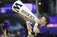 SEATTLE, WA - DECEMBER 18: Washington cheerleader Timothy Dion entertained fans during a timeout against Savannah State.  Washington won 87-36 over Savannah State at Alaska Airlines Arena in Seattle, WA.